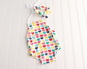 My Heart Dreams in Rainbows - newborn romper in a rainbow heart print in blues, greens, yellow, pinks and red - rainbow baby (RTS)