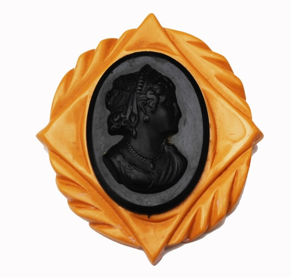Large Bakelite Cameo brooch with black and butterscotch  carved vintage plastic pin