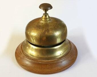 Vintage brass and wood desk hotel reception bell, Round base, Distressed worn metal