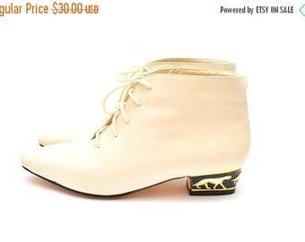 ON SALE 80s Cream Jaguar Heel Leather Ankle Boots 7 Womens