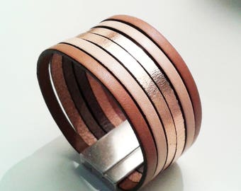 Tan and beige leather cuff is pink and rose gold with silver zamak magnetic clasp