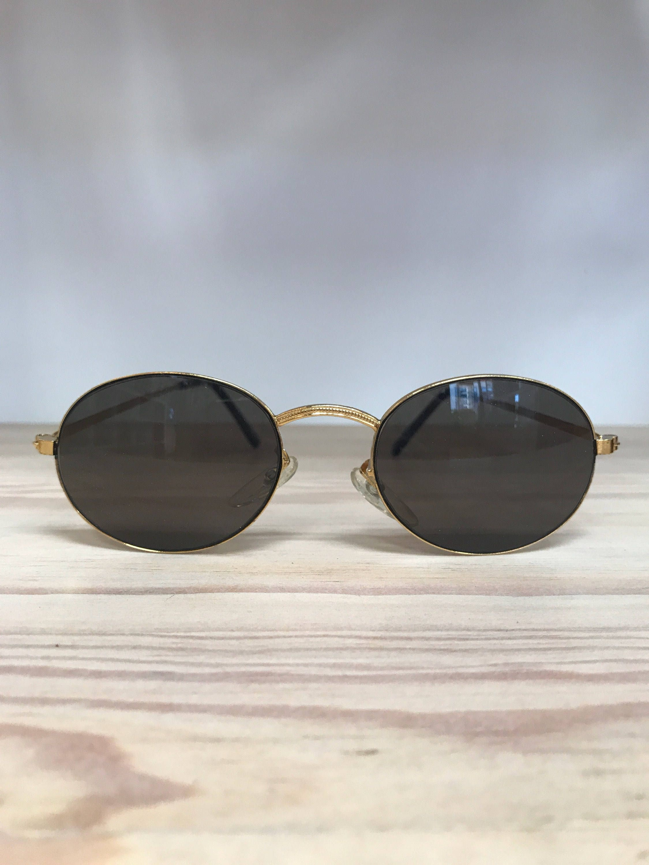 70f726ac120 Black with gold oval vintage sunglasses