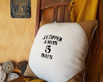 WOOL bale cushion hand made from vintage stencil with leather corners and cotton ticking back.