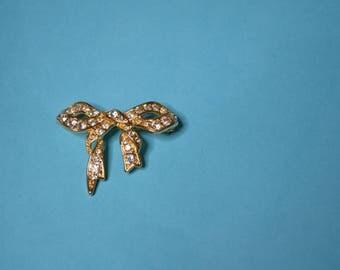 Monet Rhinestone and Goldtone Ribbon Pin