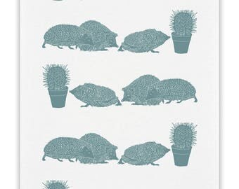 100% cotton tea towel with Hedgehogs looking at a cactus