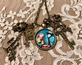 """Vintage, Charm, Pendant Necklace Featuring, 'Jack Skellington And Sally' From """"Nightmare Before Christmas"""".  Antique Bronze Tone."""