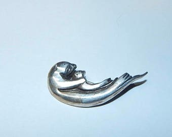 Little Sterling Silver Otter brooch.  Very cute, momma swimming on her back with baby on her belly