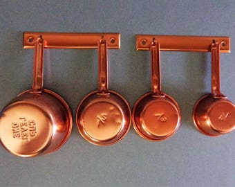 Vintage Pink Aluminum Measuring Cup Set with Hangers 1/4  1/3  1/2 and 1 cup measures copper color