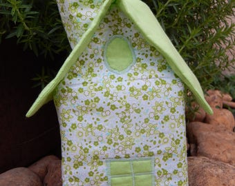 Green House with handkerchiefs with flowers and plain green roof