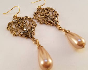 Light pink and gold dangle earrings