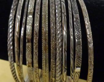 "Vintage 12 Bangle Bracelet Set with Nice Etching 8 1/2"" round"