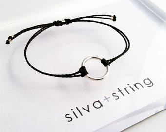silva + string | @tanyadasilvastudio | sterling silver medium circle + waxed thread bracelet