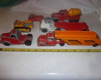 vintage 1950s Tootsie toy trucks for your electric train set up.Mack,Bulldozer,cement mixer,etc
