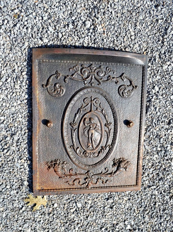Antique Cast Iron Fireplace Cover Woman Old Ornate Metal Architectural Salvage Victorian PanchosPorch  Antique cast iron fireplace cover. Ornate design with a Grecian woman in the oval center. Bronze color showing through. Numbered on the back. Gorgeous a