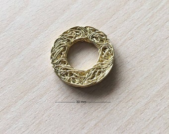 Gold circle wire charm