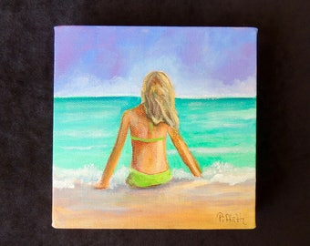 """Beautiful gallery wrapped 6""""x6"""" acrylic painting of a blonde woman sitting on the shore.  Colors are vibrant aqua's, blue and green."""