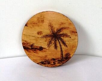 "Tropical Warmth, Woodburned Landscape, 4"" (10 cm) diameter."