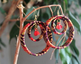 african wax earrings with oranges