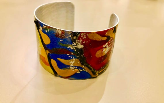 Enamel painted aluminum cuff open bracelet with abstract design (orange, blue, green, yellow, red, gold)