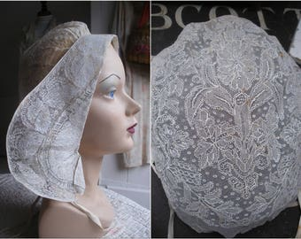 Exceptional antique Belgian lace bonnet of museum quality, pins in lappets