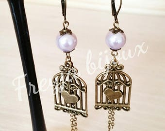 Pearl Earrings purple glass Pearl and bronze colored birdcage pendant