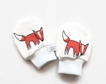 Newborn scratch mitts. Organic mittens with cuffs. Baby shower gift. Organic knit fabric with orange foxes. No scratch baby mitts
