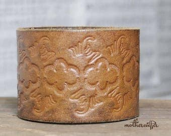 CUSTOM HANDSTAMPED light brown wide leather cuff with design by mothercuffer