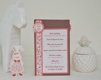 Menu table with small pretty rabbit in dress and floral patterns
