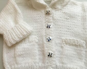 Cute little white handknitted hoodie jacket with button front