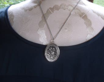 """Vintage Silver Etched Oval Locket Necklace, Floral Dogwood Flower Center with Black Enamel Work on an 18"""" Silver Chain"""