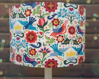 Bright and cheerful fabric lampshade in Mexican 'La Paloma Tea' material.