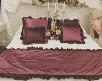 Set of two plum pillows