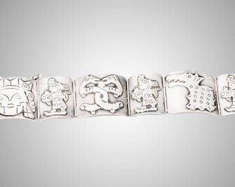 Mexican sterling bracelet with Aztec inspired panels