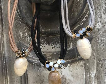 Neutral cord necklaces with crystals