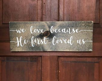 He Loved Us First hand-painted wood sign