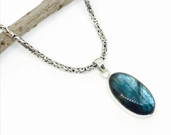 Labradorite Pendant set in sterling silver (92.5). Length- 1.75 inch.