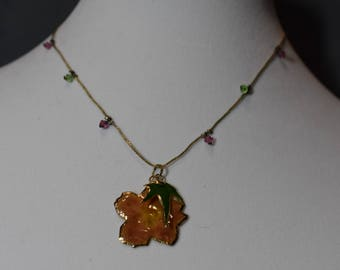 Forest flower set in gold on gold chain