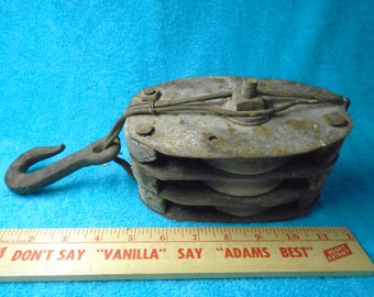Antique block and tackle. Block and tackle. 3 wooden pulley block and tackle. Pulley.  Farm implement.