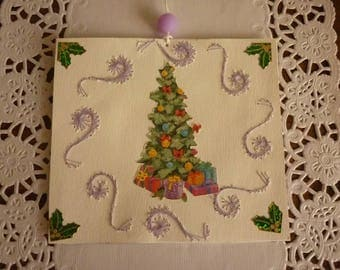 Label embroidered cardboard paper and image of Christmas tree, branch with Golden Holly.