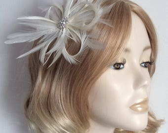 IVORY FEATHER  FASCINATOR, With hackle and biot Feathers, crystal detail, on a clip.