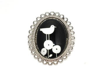 Bird on flowers costume jewelry brooch