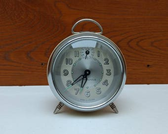 Retro French vintage Super Famous mechanical alarm clock in cream, circa 1960s.