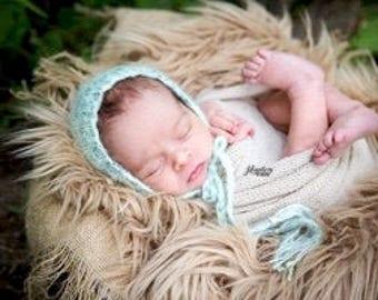 Hand knit newborn bonnet- green & blue variegated yarn
