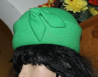 This is a FANTASTIC Hat, It is Green and a Pill Box Type of Hat, It has a Bow on it, Inside has been Fixed, Great Fashion, Church, Easter