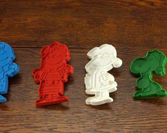 4 Peanuts Gang Plastic Christmas Cookie Cutters   Snoopy, Linus, Charlie Brown, Lucy   Very Cute!
