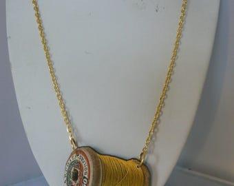 sewing bee thread  tatty vintage spool necklace woodcut lasercut yellow