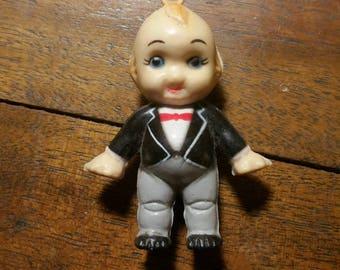 Vintage plastic Kewpie toy in a tuxedo charm