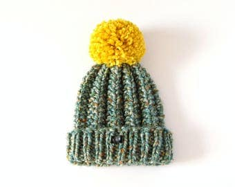 Thick chunky hand knitted beanie with extra large mustard yellow pom pom. Womens bobble hat. Green/blue grey tweed wool blend textured hat