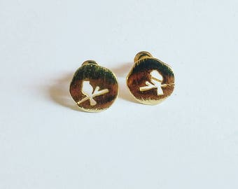 Earrings with golden bird on branch