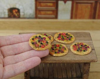 Italian pizza. Miniature in a dollhouse. Miniature. On a scale of 1/12 .